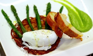 A plated meal of asparagus, egg, bread and meat at Il Canto del Maggio, Italy