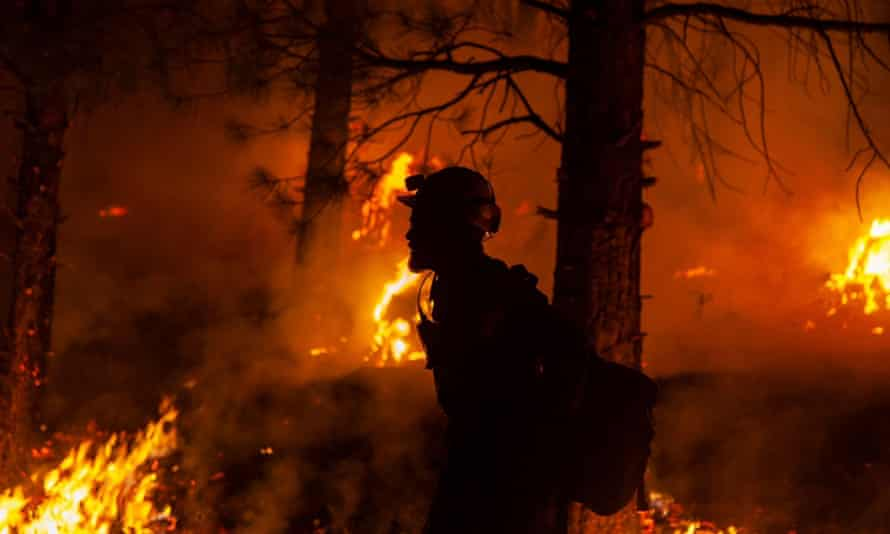 A firefighter during operations to contain the Bootleg fire, which has been raging out of control across Oregon for weeks and has spread to an area 25 times the size of Manhattan.