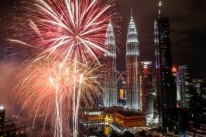 Malaysia's Petronas Towers during New Year's Eve celebrations in Kuala Lumpur