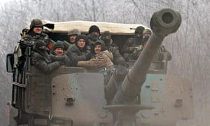 Ukrainian government soldiers ride on a vehicle between Dabeltseve and Artemivsk