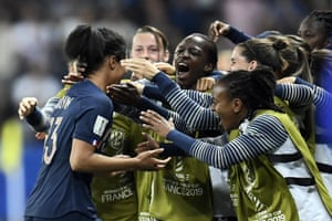 France's Valerie Gauvin is congratulated by teammates after opening the scoring.