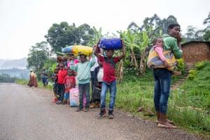 Inhabitants carrying their belongings