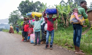 Villagers from Belo, in Cameroon's north-west, flee to nearby Bamenda