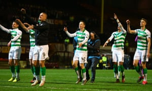 Celtic players celebrate with their fans after their 4–0 win at Motherwell.
