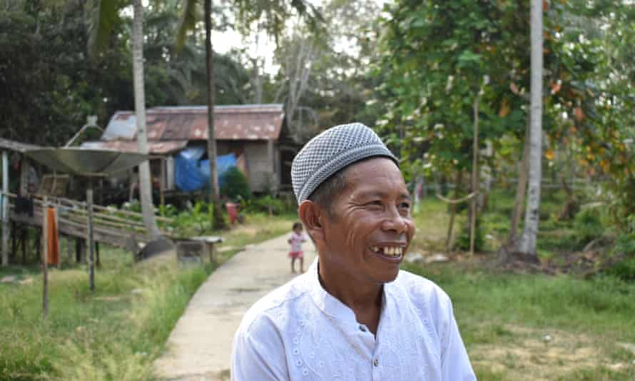 Jubaen, cultural chief of Pemaluan, a village in the development zone, fears the loss of community feeling.