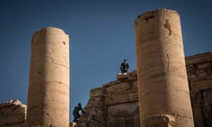 A Syrian Antiterrorism forces soldier walks on the ruins of the Temple of Bel, is an ancient stone ruin in Palmira, Syria
