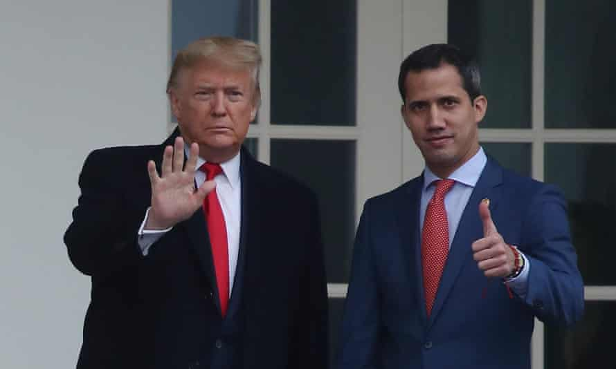 Donald Trump walks with the Venezuelan opposition leader Juan Guaidó at the White House on Wednesday.