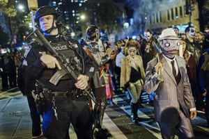 Police guard as revellers march during the Greenwich Village Halloween parade.