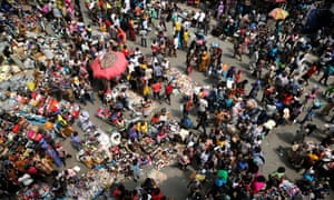 People crowd a market square in Lagos.