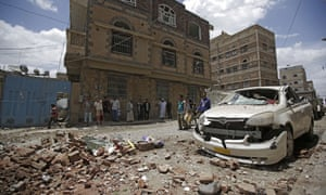 People inspect the site of an airstrike by Saudi-led coalition in Sana'a.
