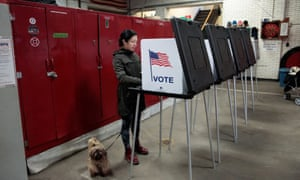 Voters cast their ballots in the Democratic primary election in Detroit, Michigan Tuesday.
