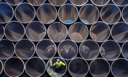 A worker inspects pipes that will be used for the construction of the Nord Stream 2