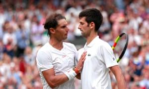 Novak Djokovic is congratulated by Rafael Nadal
