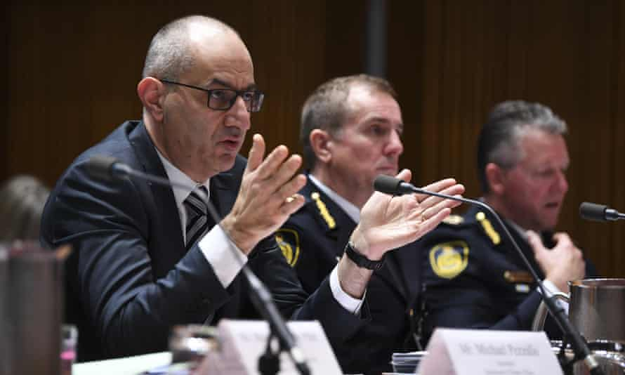 Secretary of the Department of Home Affairs Michael Pezzullo (left) speaks during the Senate Inquiry on Wednesday.