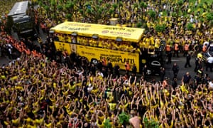 Borussia Dortmund fans and players celebrate at Borsigplatz after their triumph in the German Cup final.