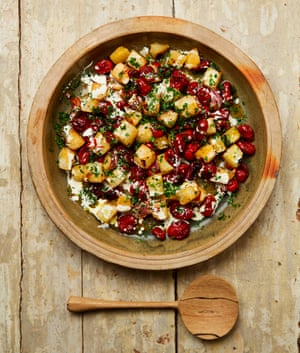 Yotam Ottolenghi's buttery roasted kohlrabi with lots of garlic and tomatoes.