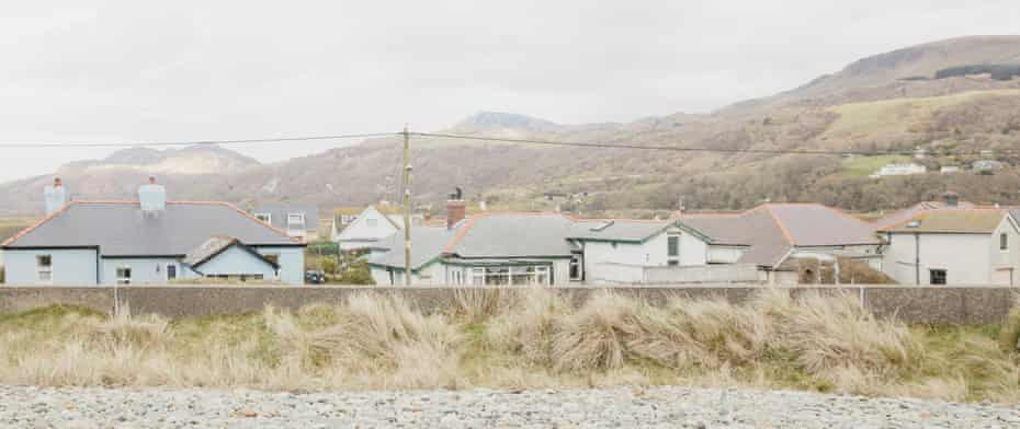 Houses behind the sea wall in Fairbourne, north Wales