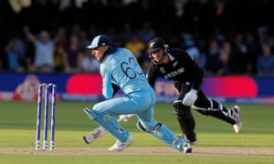 England's Jos Buttler runs out New Zealand's Martin Guptill during the super over to win the World Cup.