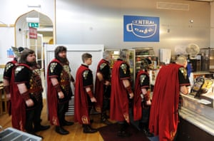 A group of Vikings queue to buy breakfast