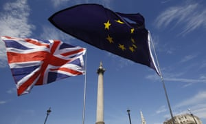 A union flag flies next to an EU flag in London. British architecture relies heavily on EU citizens