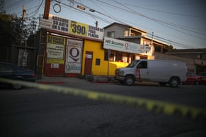 A white forensic van waits to remove the body of Brianna Rojas from her Tijuana workplace  after she was murdered there on 8 October, 2019