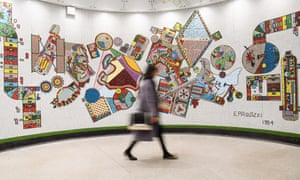 London, England A passengers passes a restored mosaic