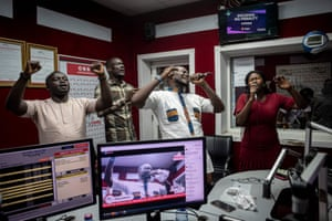 People pray and sing during a religious radio show at Accra FM station.
