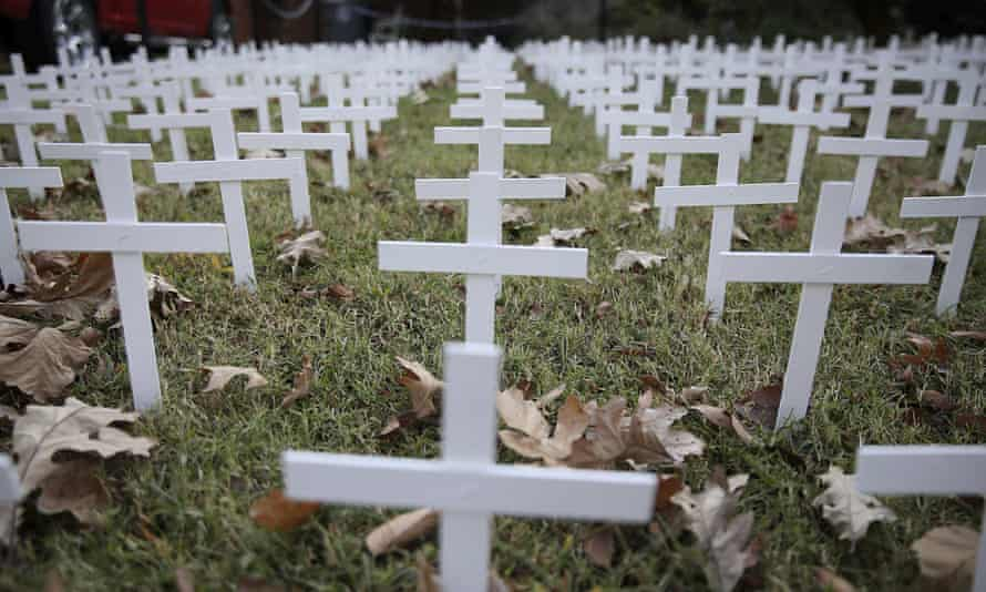 A yard in Oklahoma bears 1,006 white crosses, representing the state's coronavirus death toll.