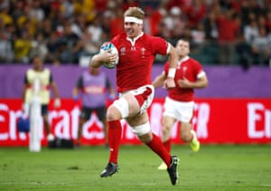 Aaron Wainwright runs in to score for Wales.