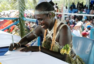 Francisca Semoso, women's candidate for north Bougainville in the 2005 elections, signs her oaths of allegiance wearing traditional dress in the northern town of Buka.