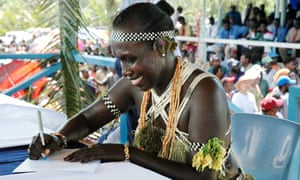 Francisca Semoso, women's candidate for north Bougainville, signs her oaths of allegiance during elections in 2005.