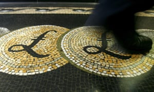 Man walks on pound symbol on mosaic