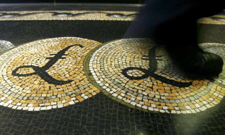 Man walks on pound symbol on mosaic