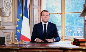 A TV screen displays French president Emmanuel Macron delivering a speech after the results from the New Caledonia independence referendum.