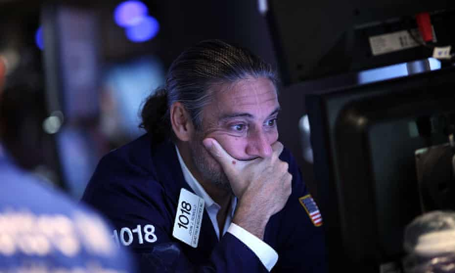 A trader on the floor of the New York Stock Exchange (NYSE) as the Dow Jones industrial average drops. Further falls in stocks could cause material damage to the Australian economy.
