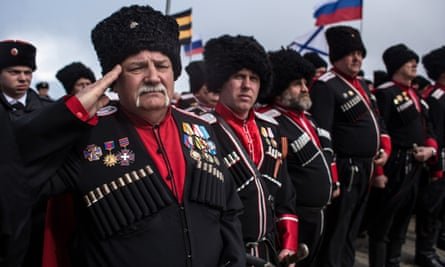 Cossacks mark the first anniversary of Russia's annexation of the Crimea.
