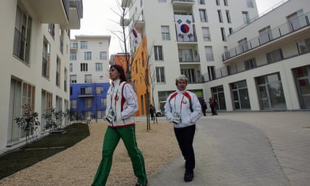 Athletes walk in the courtyard of the Olympic village.