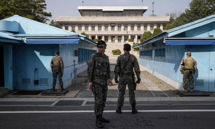 South Korean soldiers standing guard outside a meeting hut in the truce village of Panmunjom within the Demilitarized Zone.