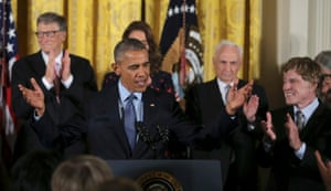 Barack Obama is applauded by presidential medal of freedom recipients at the White House