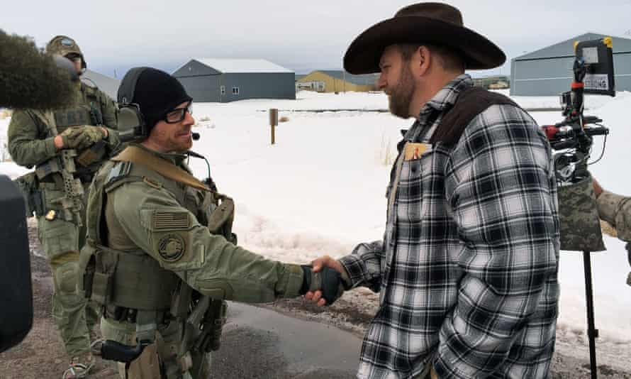 On Friday, Ammon Bundy shook hands with a federal agent as authorities attempt to resolve the three-week old standoff over federal land policies.