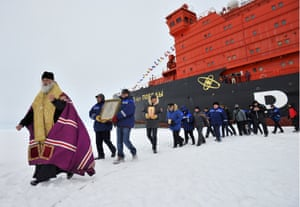 North Pole, Arctic A priest and members of an expedition by a 50 Let Pobedy nuclear-powered icebreaker follow the route of the 1977 North Pole voyage by the Arktika atomic icebreaker