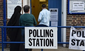 Voters go to a polling station