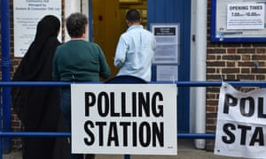 Voters enter a polling station in Camden, London, for the European elections on 23 May