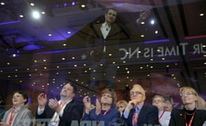 A reflection of republican presidential candidate Texas Senator Ted Cruz is photographed above members of the audience