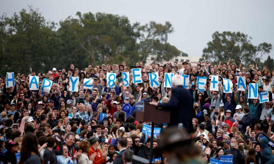 Bernie Sanders looks as supporters wish him and his wife a happy wedding anniversary at a campaign rally in Santa Barbara, California.