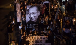 People attend a candlelight march for the late Chinese Nobel laureate Liu Xiaobo in Hong Kong.