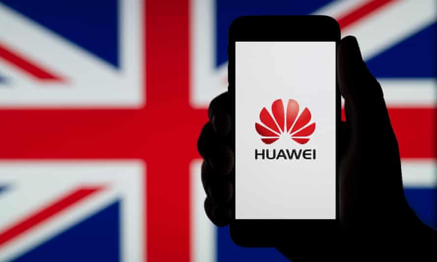 A silhouetted hand of a man holds a smartphone displaying the logo of Chinese company Huawei, with a UK flag in the background (Editorial use only).<br>TAJ206 A silhouetted hand of a man holds a smartphone displaying the logo of Chinese company Huawei, with a UK flag in the background