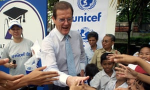 Roger Moore greets Indonesian schoolchildren during a visit to a Jakarta school on behalf of Unicef in 2001