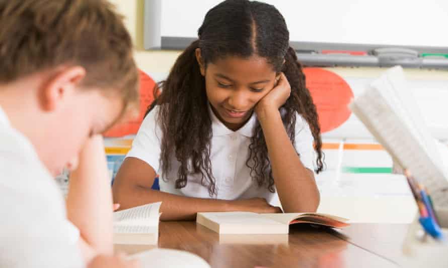 School pupils reading different books.