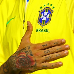 Brazil v Bolivia - Morumbi Stadium, Sao Paolo. Tattooed hand of Roberto Firmino during the national anthem.